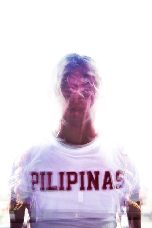 "This image contains all the members of El Gamma Penumbra superimposed all over each other. Photographer Joseph Pascual made sure there were parts of each of them. ""They work with shadows — and not all shadows are clean — so I turned them into their own shadow,"" Pascual says. The only thing visible in the photo is what unified them — the word ""Pilipinas"" on their T-shirts."